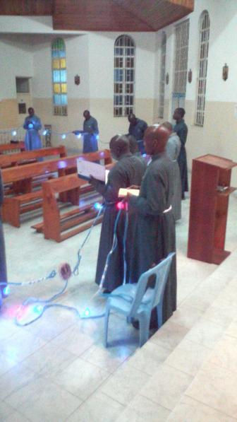 Seminarians praying an illuminated Rosary in the seminary chapel in Nairobi, Kenya