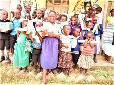 african educate children receiving supplies 2018